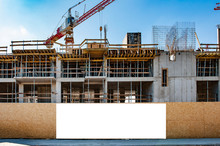 Blank White Banner For Advertisement On A Fence Of A Building Under Construction