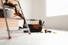 Stepladder And Different Tools In Room. Interior Renovation