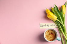 Delicious Coffee, Beautiful Flowers And Card With GOOD MORNING Wish On Pink Background, Flat Lay. Space For Text