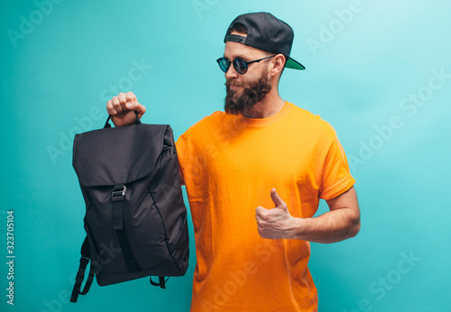 Papel de parede Handsome bearded hipster guy with black casual backpack, with space for your logo or design