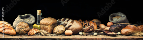 Banner with different types of bread and rolls, eggs, wheat, rye, sunflower oil and ears Canvas Print
