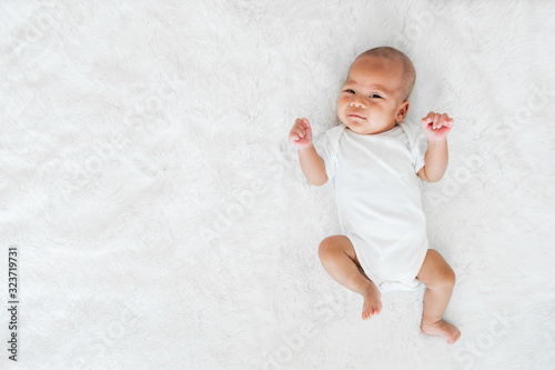 Portrait baby adorable on white bed, newborn concept