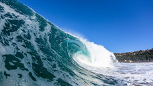 Hollow Crashing Ocean Wave Closeup Swimming Photo With Textures On Wall Of Water With Blue Sky Panoramic Beach Coastline.