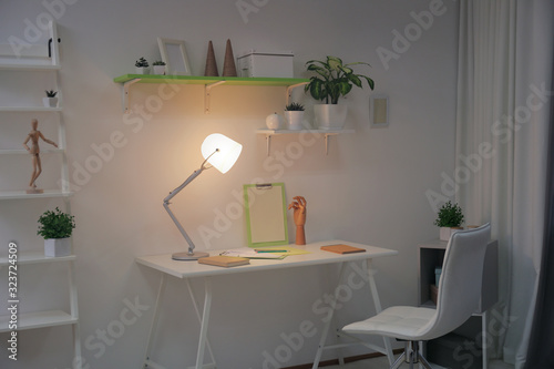 Stylish room interior with comfortable workplace. Design idea