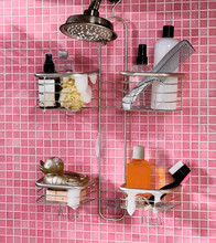 Metal Shower Caddies Hanging In Pink Tiled Bathroom