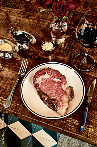 Overhead view of place setting with steak and red wine - 323743349