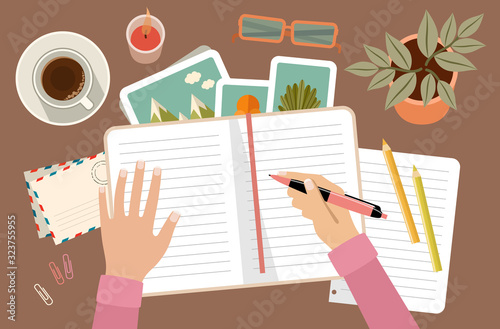 Woman s hands holding pen and writing in diary. Personal planning and organization. Workplace #323755955
