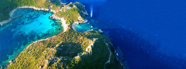 Aerial drone wide photo of paradise exotic lagoon with turquoise rocky beach