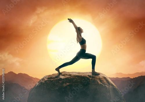 obraz PCV Woman is practicing yoga
