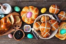 Easter Table Scene With A Selection Of Fresh Breads. Top View Over A Dark Wood Background. Spring Holiday Baking Concept.