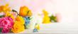 Leinwandbild Motiv  Beautiful spring flowers on white wooden table. Festive concept with copy space.