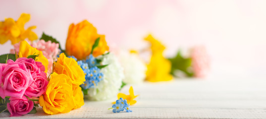 Beautiful spring flowers on white wooden table. Festive concept with copy space.