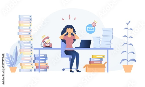 Fotografía Stressed overworked woman in an office seated at her desk surrounded by heaps of