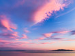 Leinwandbild Motiv Tender pink clouds in the blue sky, natural colors