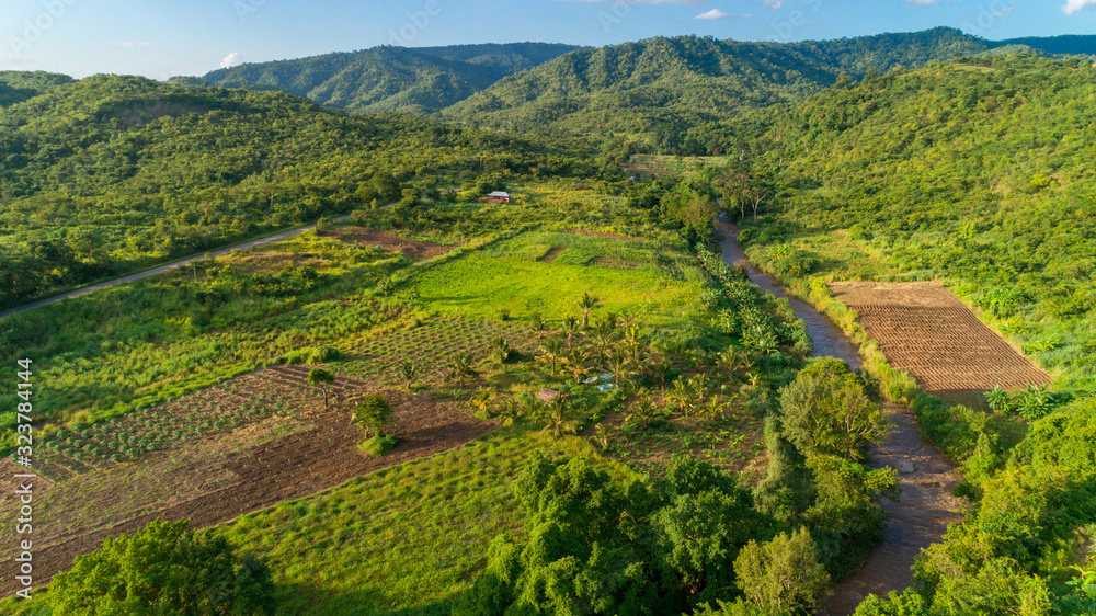 Fototapeta Aerial view of endless lush pastures and farmlands of morogoro town, Tanzania