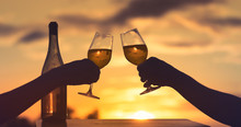 People Enjoying Wine At Sunset...