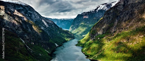 Fototapeta  Panorama of beautiful valley with mountains and river in Norway obraz