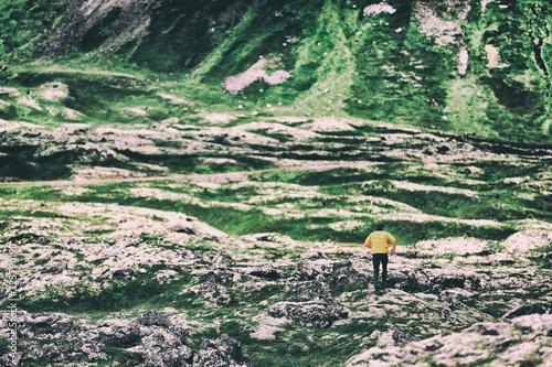Trail run athlete running on mountain nature background ultra runner on long distance trek. Endurance sport hiker on trek hike. Landscape spring or winter.