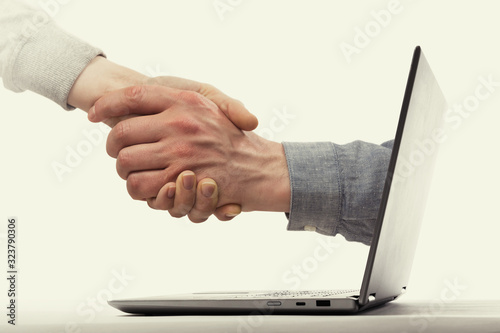 A deal between two partners from the laptop Wallpaper Mural