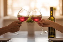Pair Of Hands Toasting Glass O...