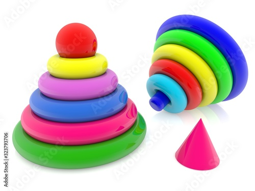 Colored toy pyramids on a white background
