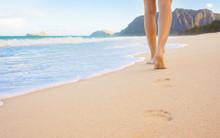 Female Walking Barefoot On Whi...