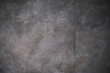 Abstract artistic background. Dark grey canvas backdrop with textured stains.