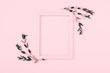 canvas print picture - Minimal composition of eucalyptus. Photo frame, eucalyptus branches, leaves on pastel pink background. Valentines Day, Easter, Happy Women's Day, Mother's day. Flat lay, top view, copy space