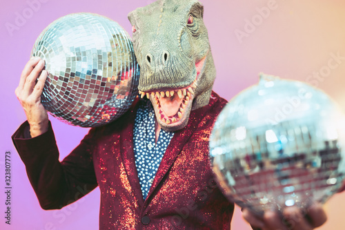 Senior man having fun wearing t-rex mask in discotheque - Elegant dinosaur masqu Wallpaper Mural