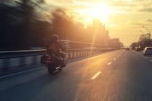 Silhouette Of Biker Riding Bla...