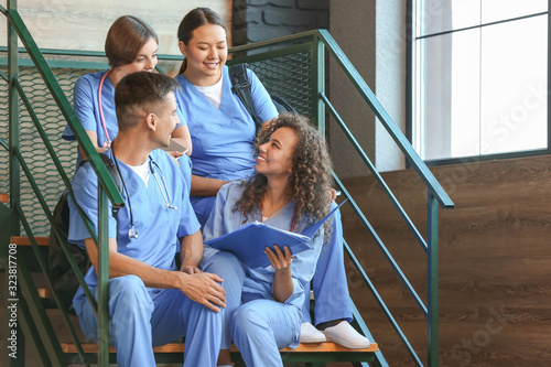 Group of medical students on stairs in modern clinic
