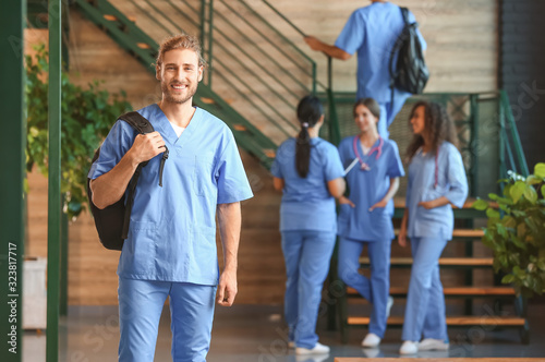 Group of medical students in corridor of modern clinic