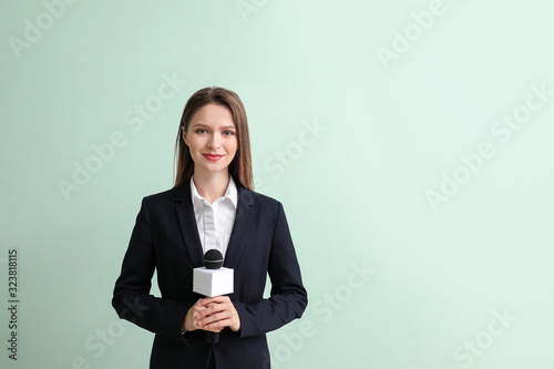 Female journalist on color background