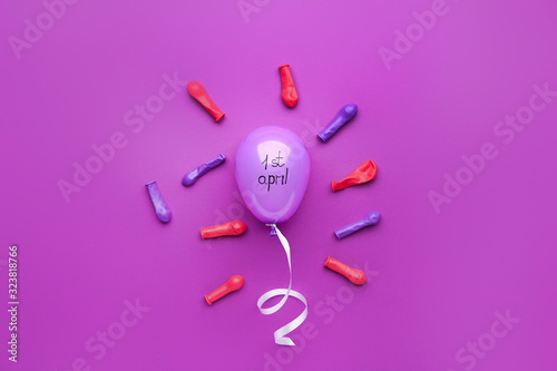 Air balloons on color background. April Fool's Day prank