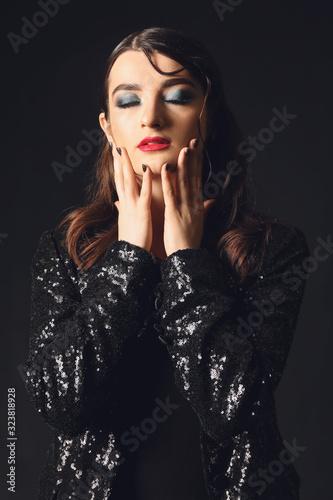 Beautiful fashionable woman on dark background