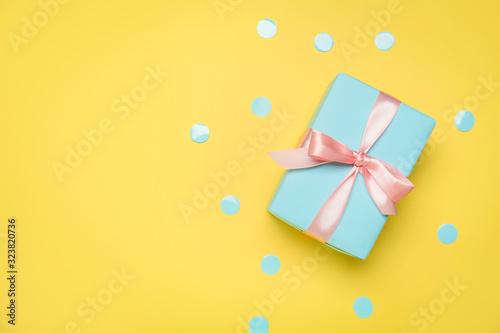 Fotografija Beautiful gift box on color background