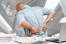 Business Man With Back Pain In...