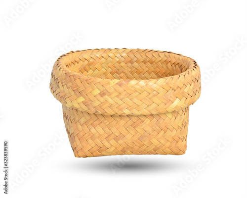 Fotografia, Obraz Woven basket, made from Krajood (Sedge) isolated on white and clipping path