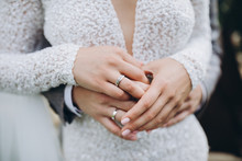 Wedding Guy And Girl In A White Dress Holding Hands On Fingers Wedding Rings