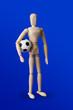 Leinwandbild Motiv Football wooden toy figure on blue