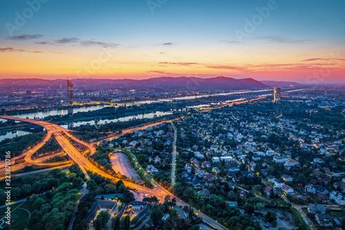 Obraz na plátně View over Vienna with danube river at night, Vienna, Austria
