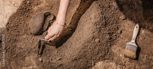 Archaeologist Uncovers Ancient Pottery Object Canvas Print