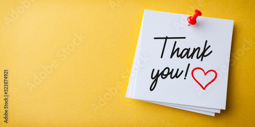 White Sticky Note With Thank You And Red Push Pin On Yellow Background Wallpaper Mural