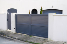 Steel Big Grey Metal Gate Fence On Modern House Street