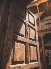 Closeup Toned Image Of Open Wooden Door Leading To Beautiful Inner Court Of Old House