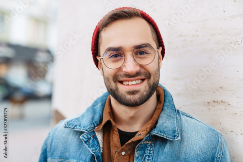 Close up of a handsome young stylish bearded man