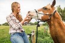 Western Girl Leading And Riding Horse Bareback In Pasture. Bridger, Montana, USA