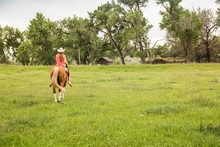 Western Girl Leading And Ridin...