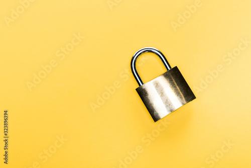 top view of metallic locker isolated on yellow