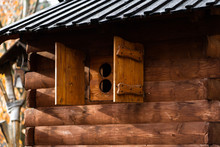 DIY Wooden Playhouse For Children With Slide On A Hillside In A Sunny Day. Modern Unusual Bright Wooden Playground Children's Lodge In Forest. Children Rest And Childhood Concept.